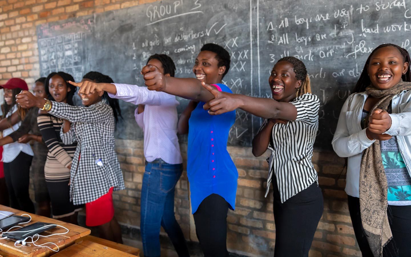 Refugee students from the Democratic Republic of the Congo participate in the Iteme Programme in Huye, Rwanda, which helps refugees and host community students improve their English and math which will increase their chances of being admitted in higher education programmes. © JULIA CUMES