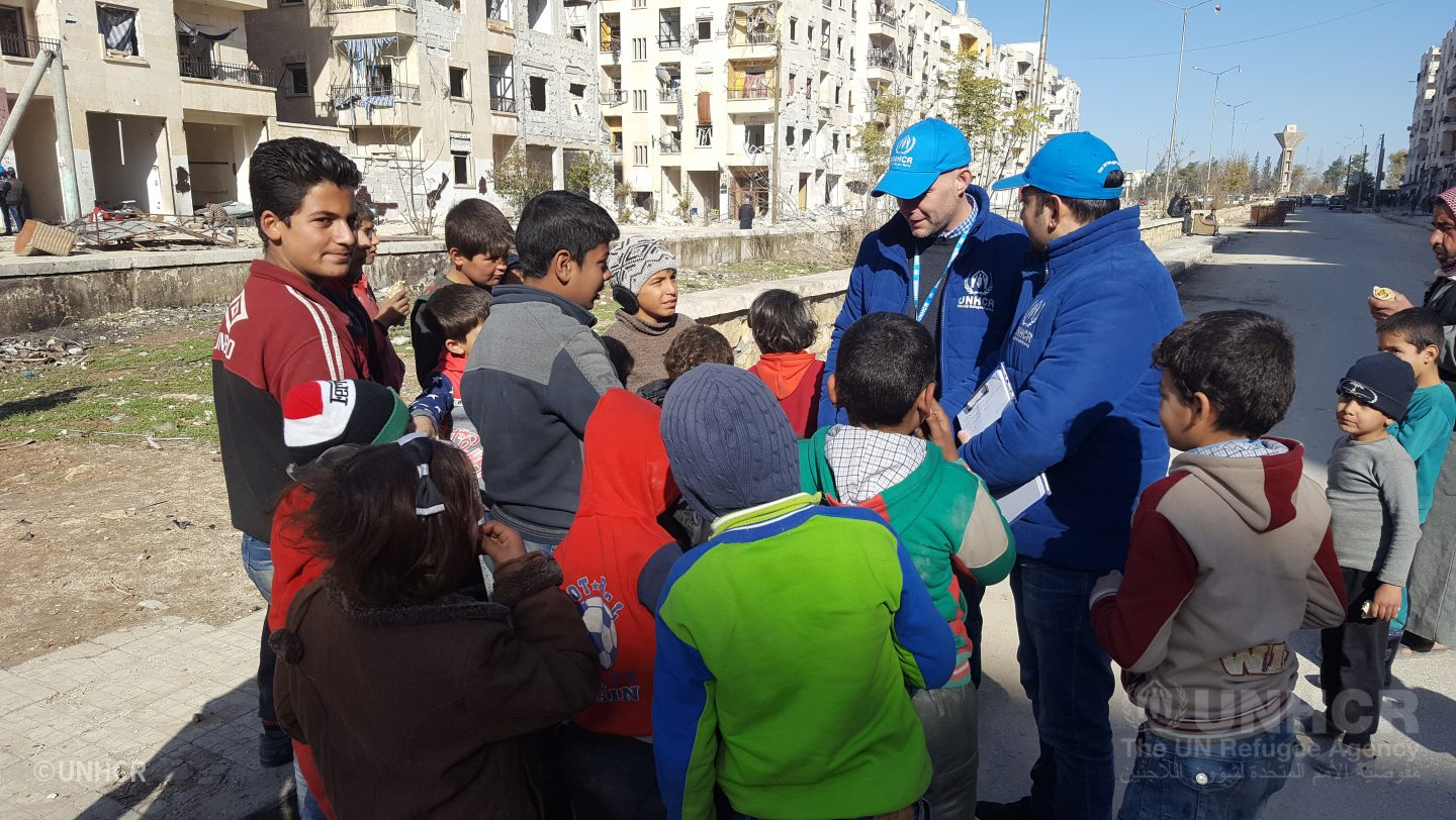 UNHCR staff visit displaced families to assess the needs in Hanano neighbourhood
