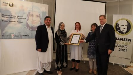 The Ambassador of Switzerland, Bénédict de Cerjat, the UNHCR Representative, Noriko Yoshida, the Chargée d'affaires of Norway, Elin Kylvåg, and the Chief Commissioner for Afghan Refugees, Saleem Khan, presenting an award certificate to the regional winner for Asia of the Nansen Refugee Award, Dr. Saleema Rehman, at the event in Islamabad. © UNHCR/Asif Shahzad