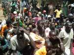 South Sudanese refugees wait to be registered at a crossing into Ethio...