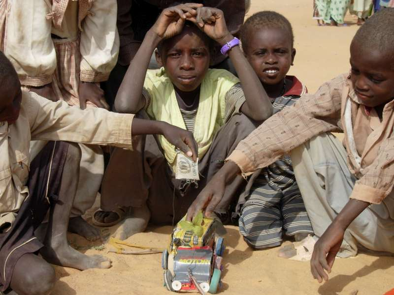 A Sudanese refugee boy with a makeshift toy truck he has built […]
