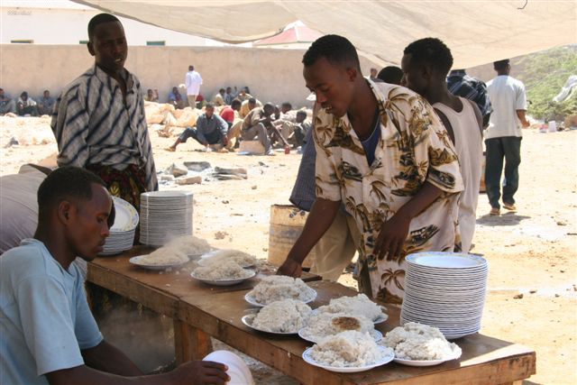 At feeding centres in Bossaso, Ethiopians who can't afford to go home or leave with people smugglers for Yemen, wait for the twice-daily food.