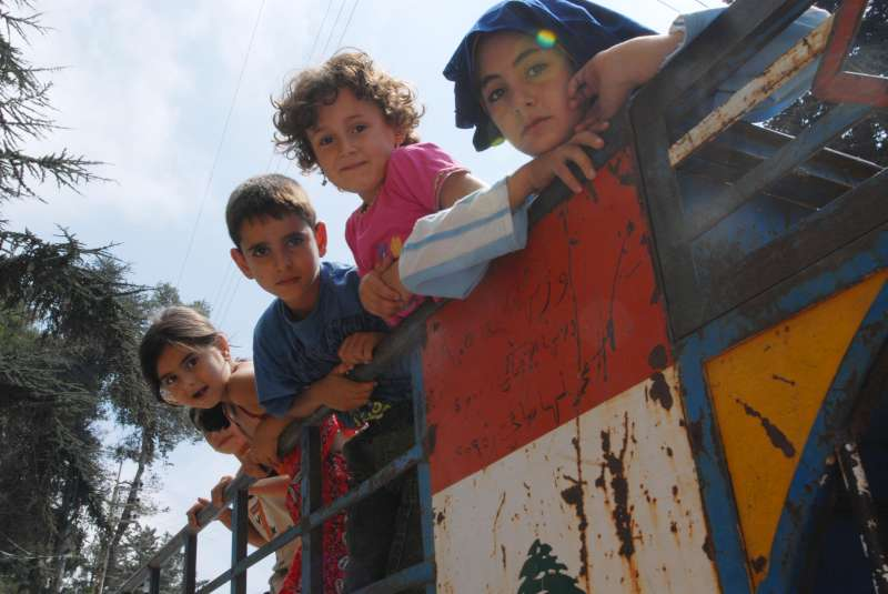 A group of displaced children arrive in the Aley valley, north […]