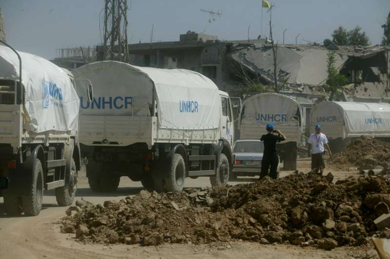A UNHCR convoy carrying emergency tents, mattresses and blankets, arrives in the southern Lebanese town of Siddiqine.