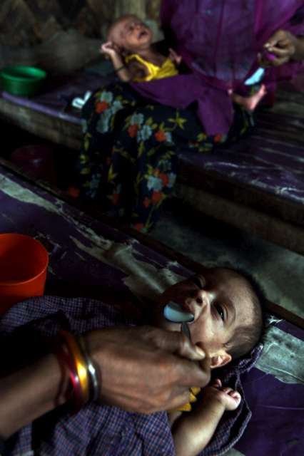 A mother feeds her child milk at the feeding centre in Nayapara camp, Cox's Bazar district.