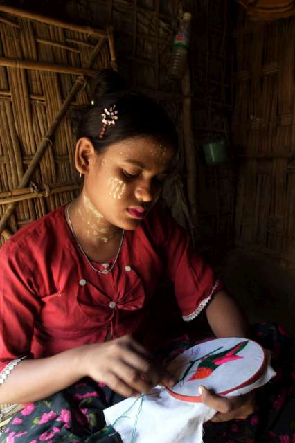 A young woman learns embroidery in Nayapara camp, Cox's Bazar district.