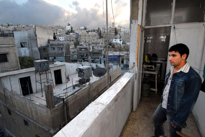 An Iraqi refugee looks out over Amman. Of the estimated two million […]
