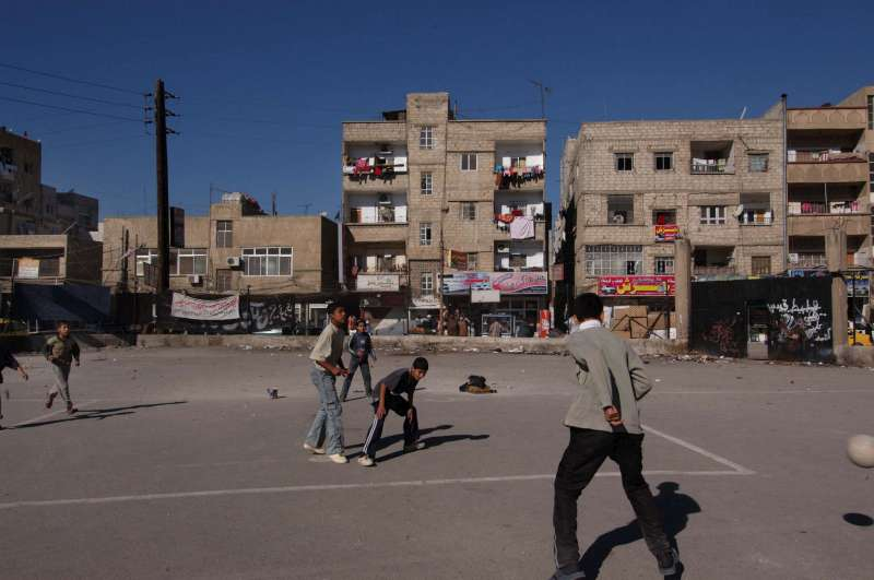 Young Iraqis play soccer in a district of Damascus. At least […]