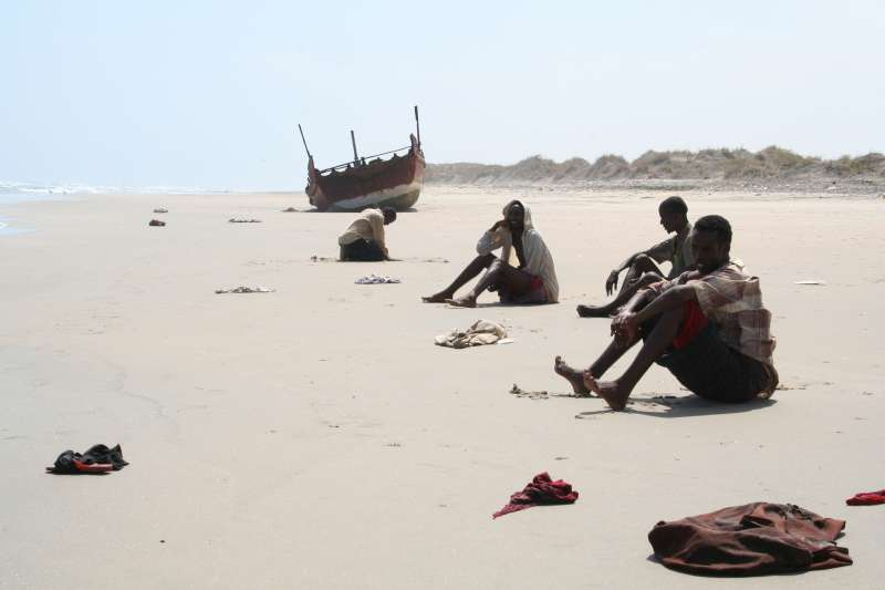 Exhausted survivors of the Gulf of Aden crossing wait for help on a beach in Yemen. From the start of 2007 until late March, well over 100 deaths at the hands of people smugglers were recorded.