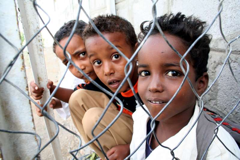 Young students who crossed the Gulf of Aden take a break at the elementary school in Kharaz refugee camp.