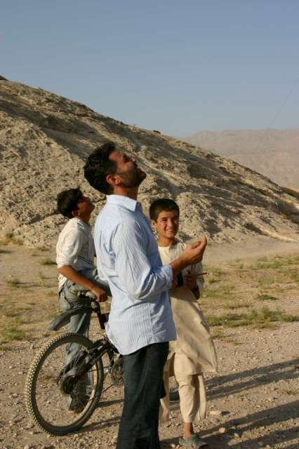 Khaled Hosseini flies kites with children at the Samangan caves in Balkh province.