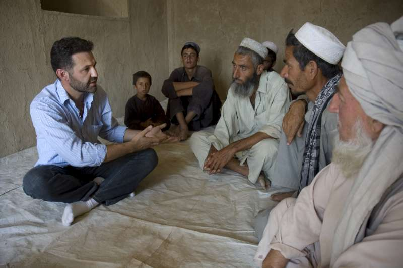 Khaled Hosseini hears from village elders in Baghlan province about the conditions his community is facing. This cluster of 24 families in Darkhat has no drinking water, medical facilities or schools.