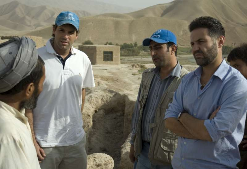 Khaled Hosseini tours a UNHCR shelter project with humanitarian project officer, Alex Mundt, in Kunduz. Those living here returned from Iran three years ago.