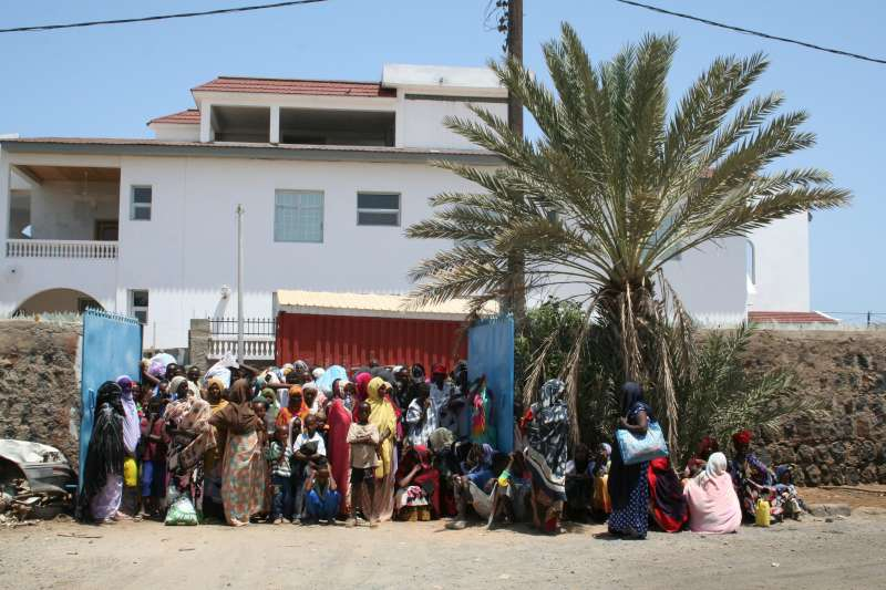 Somalis and Ethiopians crowd outside the Djibouti Refugee Agency office in the capital, Djibouti.