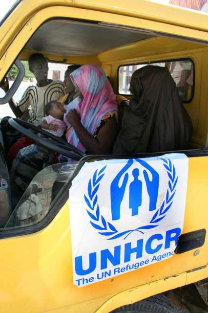 Refugees and migrants, including a baby, are picked up at a security post in the fishing village of Broom, Yemen by a UNHCR truck that will bring them to the Mayfa'a reception centre.