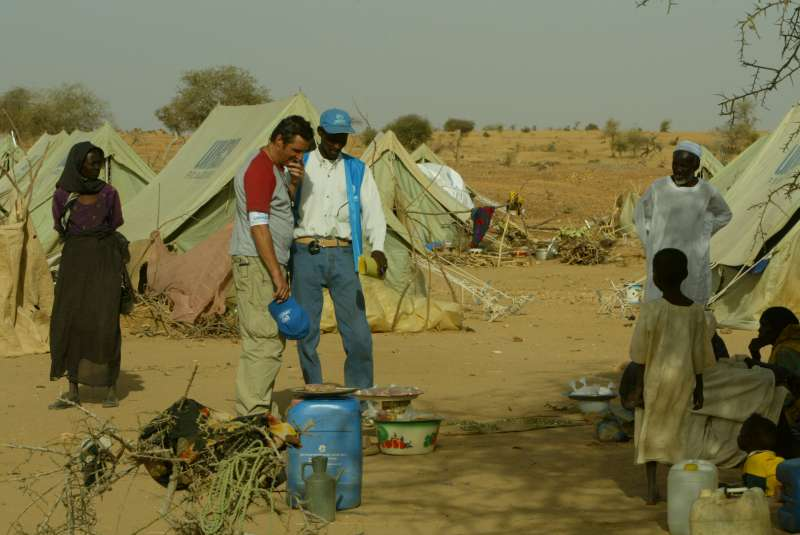 UNHCR Goodwill Ambassador Julien Clerc sees the living conditions of Sudanese refugees in Kounoungo camp, eastern Chad. March 3, 2004.