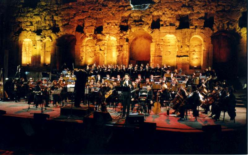 UNHCR Goodwill Ambassador George Dalaras performs with the 90-member Kamerata Orchestra and a choir during a concert in Athens to mark UNHCR's 50th Anniversary.