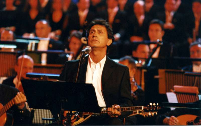 UNHCR Goodwill Ambassador George Dalaras performs in Athens at the ancient Herod Atticus theatre during one of two high-profile benefit concerts he gave in 2001 to mark UNHCR's 50th Anniversary commemorations.