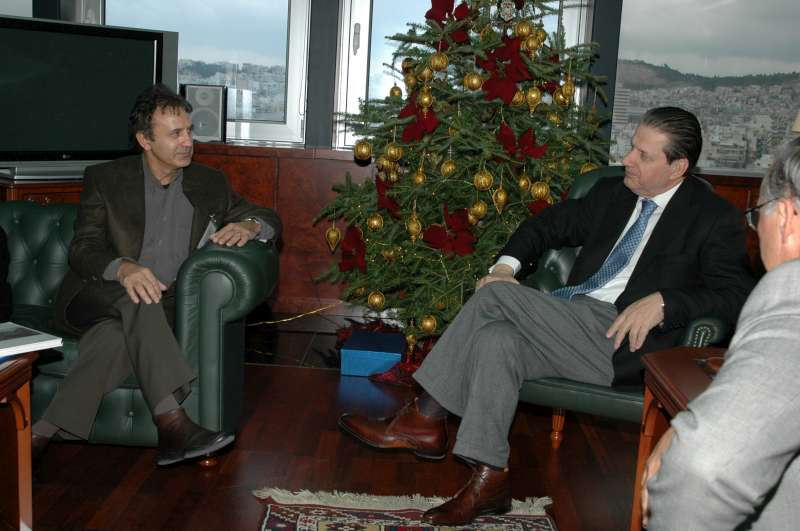 UNHCR Goodwill Ambassador George Dalaras (left) discusses refugee protection issues during a meeting on December 13, 2006 with Greek Minister of Public Order Vyron Polydoras.