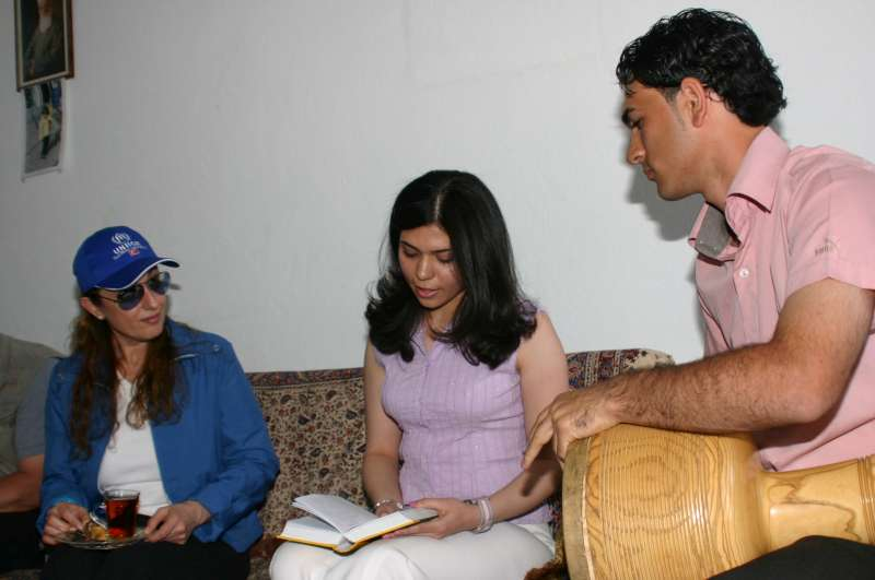 Visiting a refugee family in Aksaray, Turkey in June 2006, Muazzez listens to their experiences.