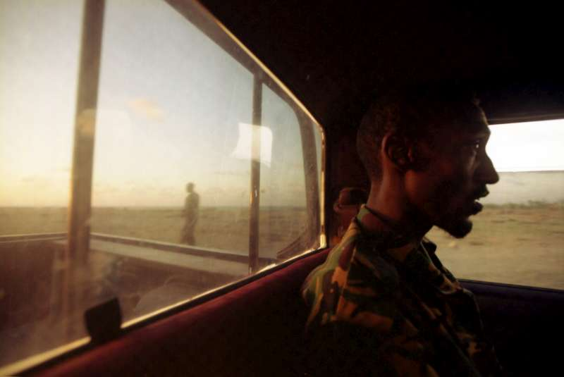 A police patrol car makes its way along the Puntland coast road on the look out for arms and people smugglers.