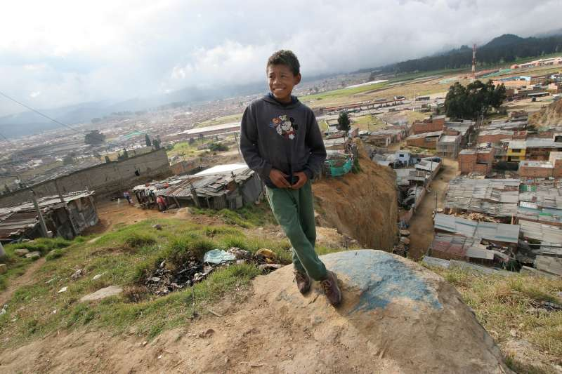 "Barrio ""Altos de la Florida"", shantytown, Bogota. An IDP child stands where one of his friends recently fell down a 50 meters high rock barrier located just next to their houses."
