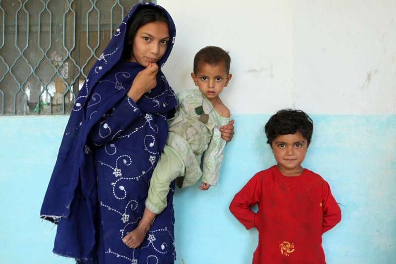 Displaced children living in a school near the town of Mardan. […]