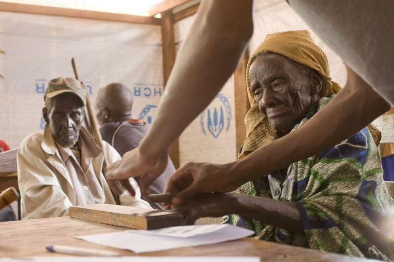 "Tanzania / 1972 Burundian refugees / An old man and his wife, who fled to Tanzania in 1972, being fingerprinted as part of the naturalization application process. Ogeste Gelvasi also hopes to be naturalized. ""My joy will be like a woman who has been pregnant for so long and has the pain, the labour of childbirth. Afterwards, she holds the thing she loves most and doesn't feel the pain that passed. I will be the same when I get citizenship in Tanzania."" UNHCR / B. Bannon / November 2008"