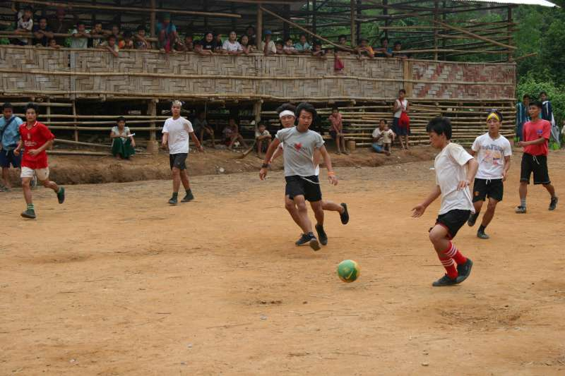 Thailand / Visit of Council of Business Leaders to Ban Don Yang Refugee Camp, on the Thai-Myanmar border, home to 3,483 mainly Karen refugees who have fled fighting in Myanmar (Burma) over the last 10 or more years. Refugee boys playing soccer with ninemillion.org ball. / / 2 May 2007