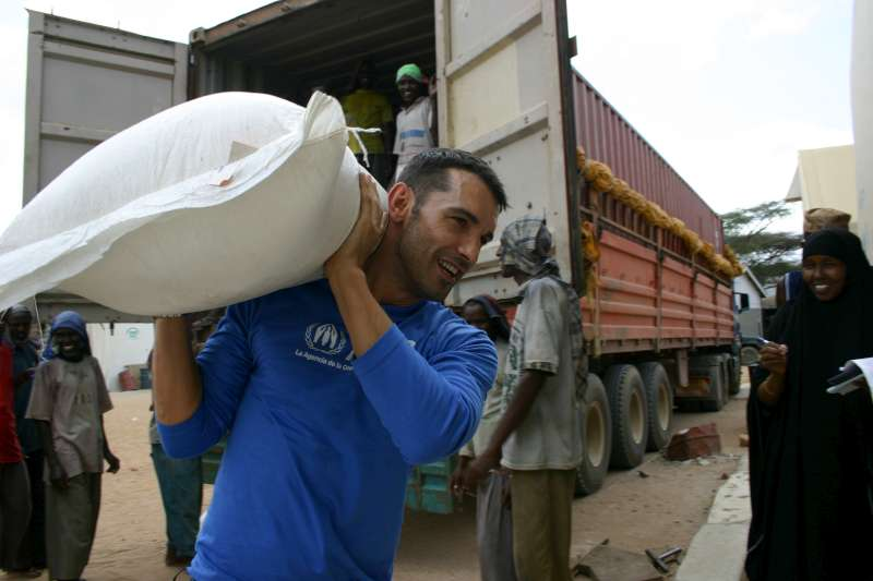 Jesús Vázquez helps unload bags of food at a warehouse in Hagadera camp, Dadaab, Kenya