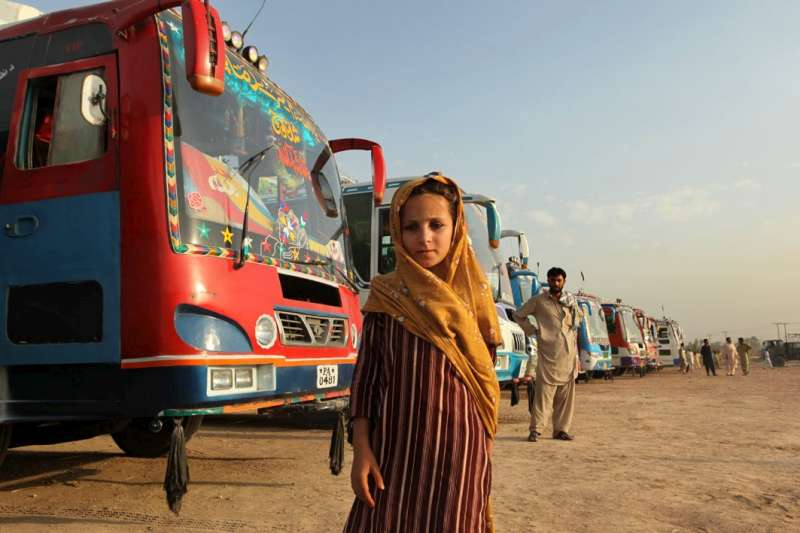 A young girl gets ready to board one of the buses in Jalozai […]