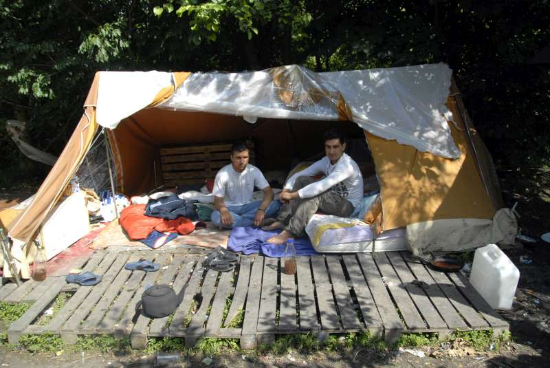 Afghan men sit in their makeshift shelter in the woods near Dunkerque […]