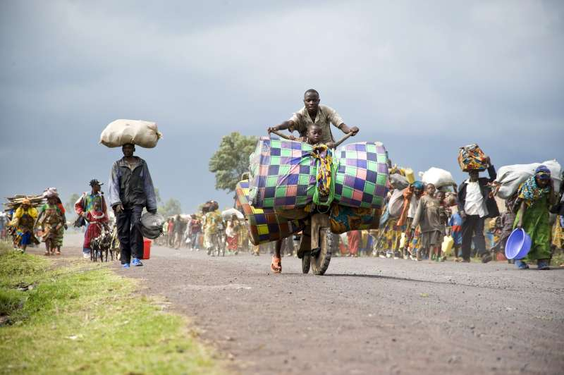 Thousands of people flee the IDP site at Kibati, in Democratic Republic of the Congo's North Kivu province, after hearing gunfire.
