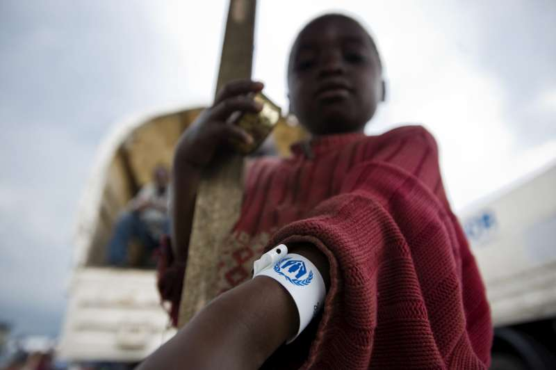 An internally displaced Congolese child displays his UNHCR arm tag prior to being transferred, along with other vulnerable civilians, to the Mugunga 1 camp in Democratic Republic of the Congo.