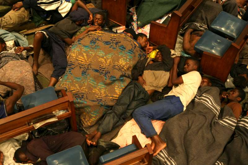 Every evening, the Central Methodist Church in Johannesburg, South Africa, provides shelter to almost 4,000 Zimbabwean refugees. People sleep wherever they can find space.