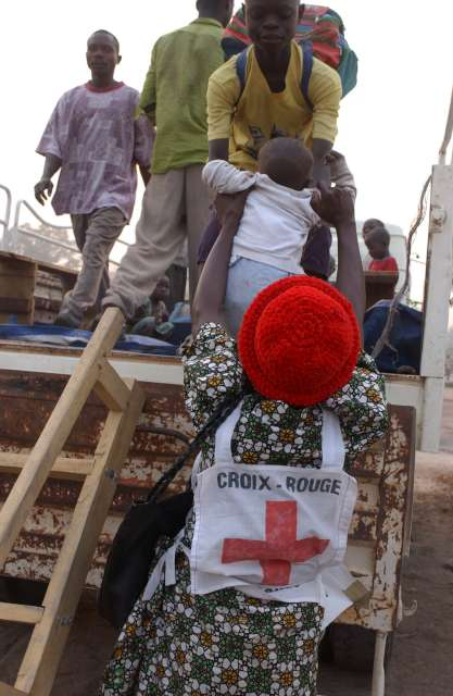 Angolan refugees in the Democratic Republic of the Congo board trucks at Divuma camp for the return home.