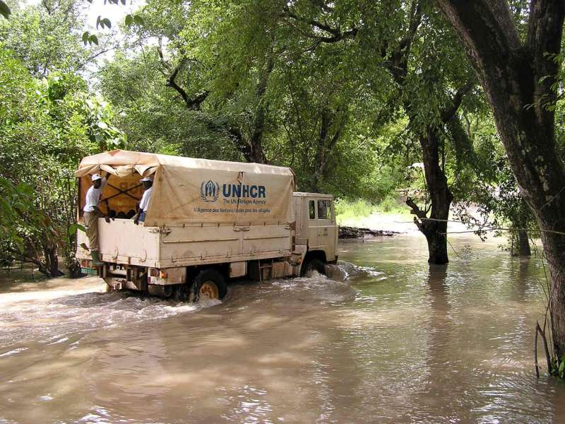 At the Chadian border town of Bettel, a UNHCR truck makes its way through floodwaters to transfer some 10,000 new arrivals from the Central African Republic to the Chad town of Gore.