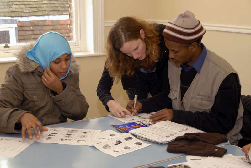 These Ethiopian refugees are receiving a language lesson after being resettled in the United Kingdom.