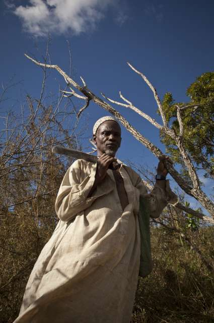Chief Yero, 63, stands in his field near Wourodoji, Cameroon. […]
