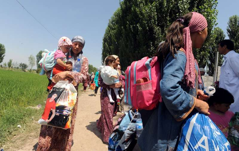Thousands of civilians return home to southern Kyrgyzstan despite not having any place to stay.