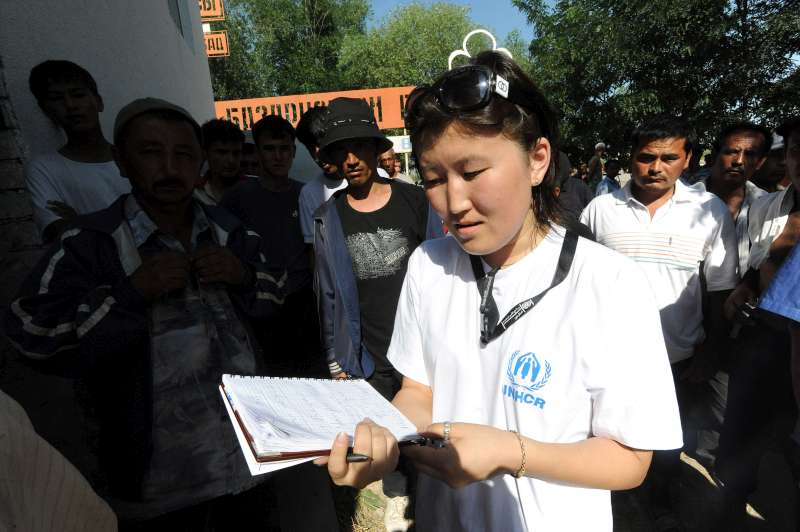 A UNHCR staff members talks with displaced people in the south of Kyrgyzstan.