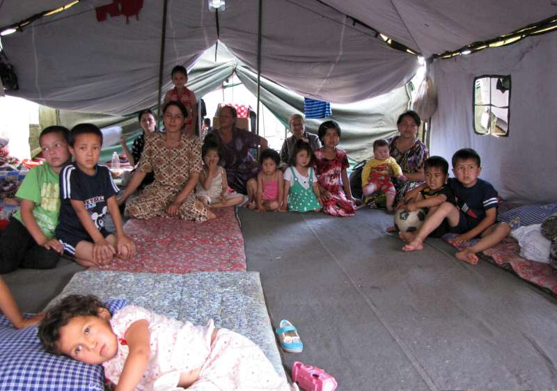 Newly arrived refugees from Kyrgyzstan sheltering near the border.