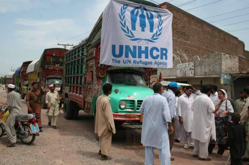 A convoy of UNHCR trucks loaded with relief items for flood survivors in Charsada district in north-west Pakistan.
