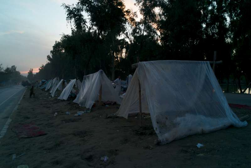 A makeshift camp along the trunk road. People without any means to rent accommodation have been forced onto this patch of high ground.