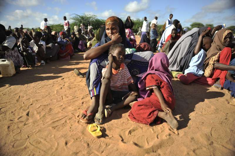 Kenya / Somali Refugees / Dadaab / Newly arrived refugees from Somalia wait for registration at IFO camp.  / UNHCR / R. Gangale / May 2010