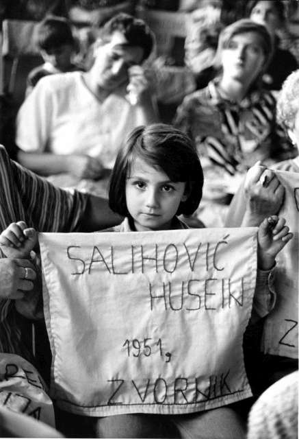 War in the Balkans in the 1990s displaced 3 million people and 8,000 men and boys from the Bosnian Muslim enclave of Srebrenica were executed. Women and children mourn the deaths of their menfolk one year after the fall of Srebrenica.