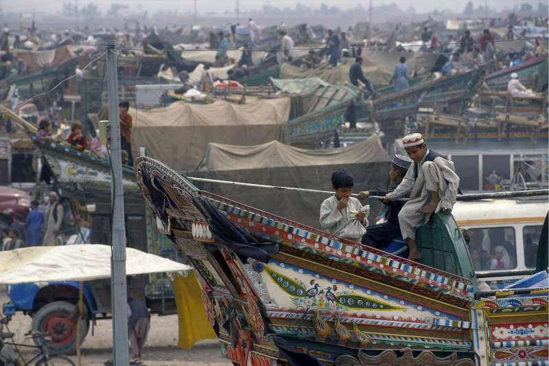 Afghan refugees prepare to return home in 2002 from a staging post near the northern Pakistani city of Peshawar.