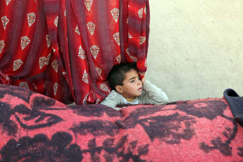 A displaced boy rests in Al-Mushraf settlement in Mosul.