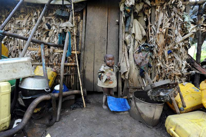 A child in front of his family's crude shelter in Kilimani Camp […]