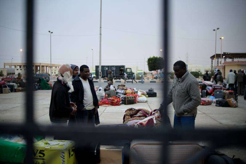 More than 3,000 people are stranded at the Egyptian border post of Sallum, awaiting onward travel.